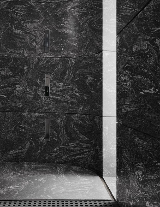 rounded black solid surface panels in a modern shower room