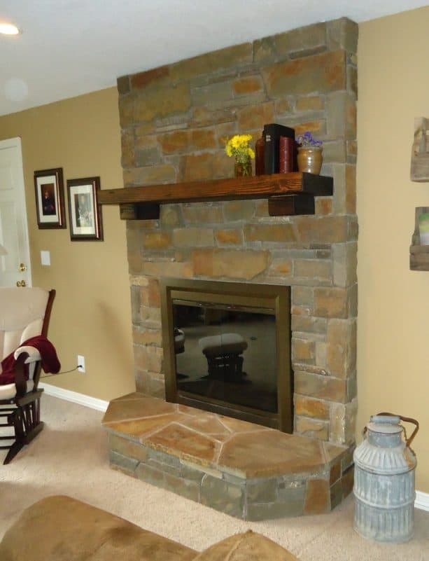 after makeover floor to ceiling natural stone fireplace with neutral wood toned mantel shelf