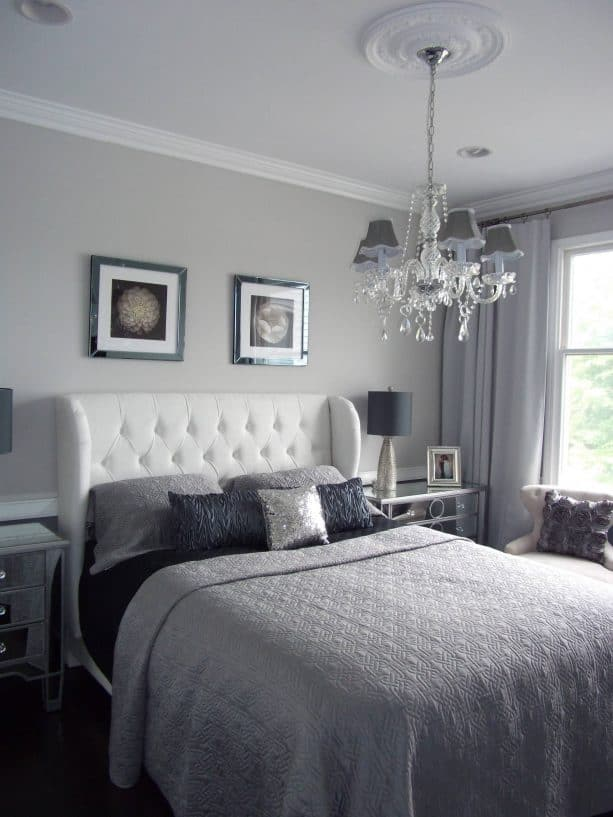 bedroom with grey wall and white bed