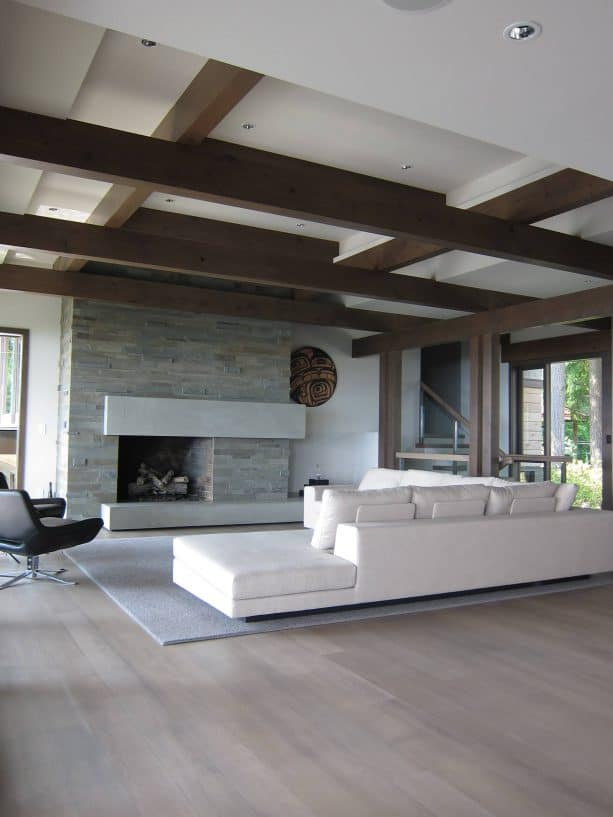 wall-size fireplace surround from gray blue limestone paired with white oak wood floor