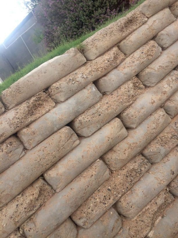 this is how the retaining wall looks like after the concrete bags degraded