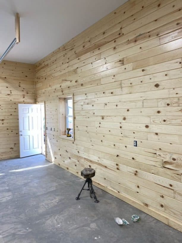 the interior walls are covered decoratively with finished, knotty wood siding