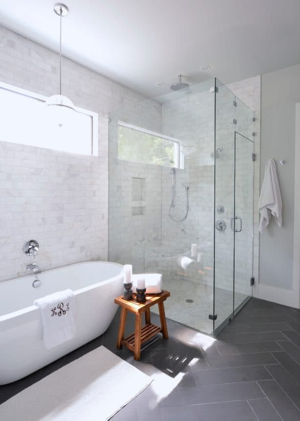 grey and white bathroom with wooden stool