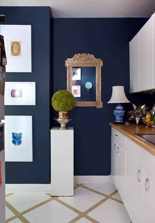 eclectic kitchen with white cabinets and Benjamin Moore Stunning wall paint color