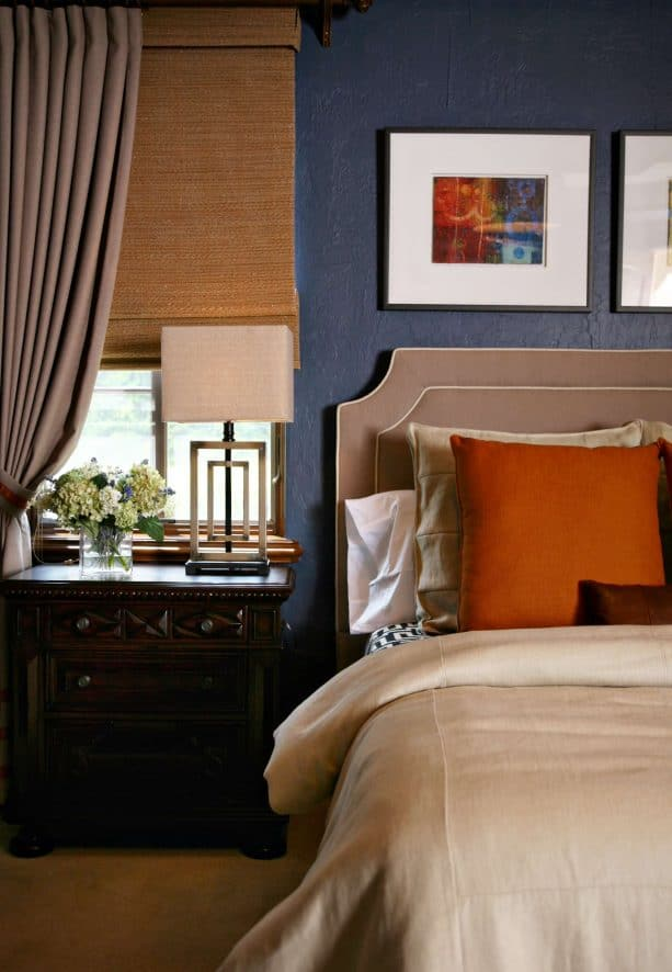 matte blue wall and oat tan curtain in a contemporary bedroom