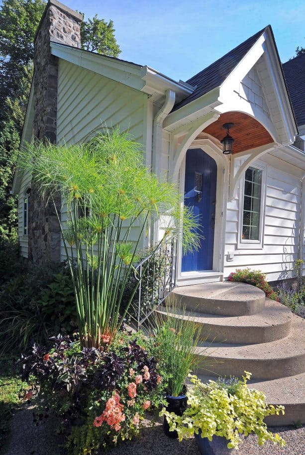 a small cottage front door with Benjamin Moore Downpour Blue