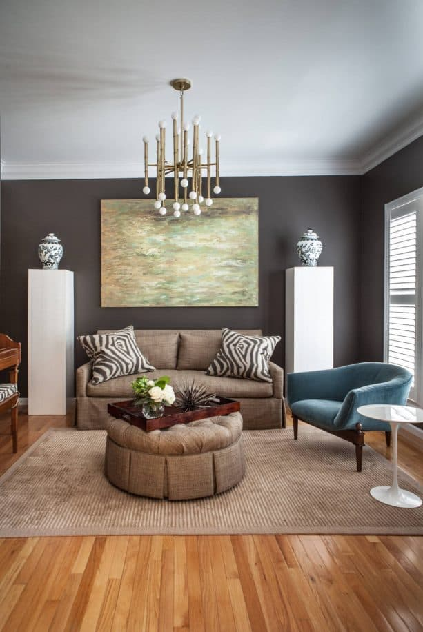 grey and brown living room with zebra print pillows