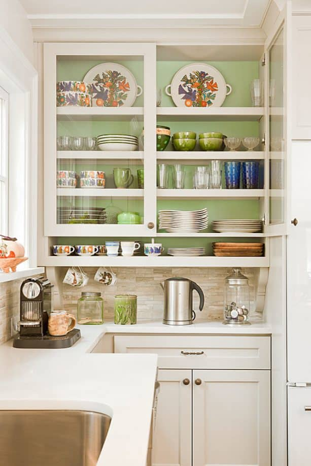 cabinets with soft green inner and glass doors
