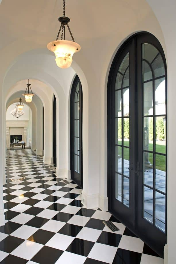 white hallway with black French doors