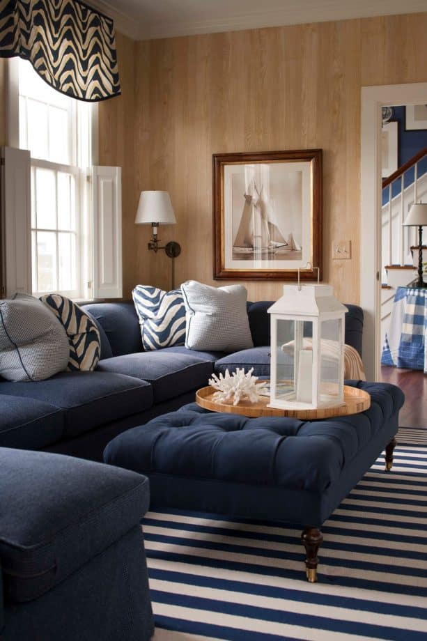 navy blue sectional couch with light grey pillows