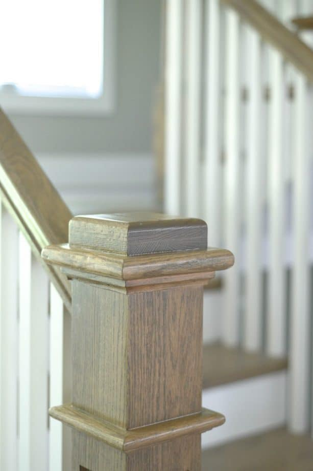 staircase newel and handrail with the mix of Minwax Weathered Oak and Classic Gray
