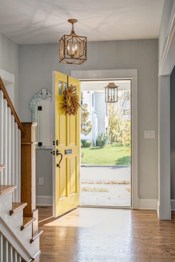 craftsman entry with grey walls, hardwood floor, and a yellow door