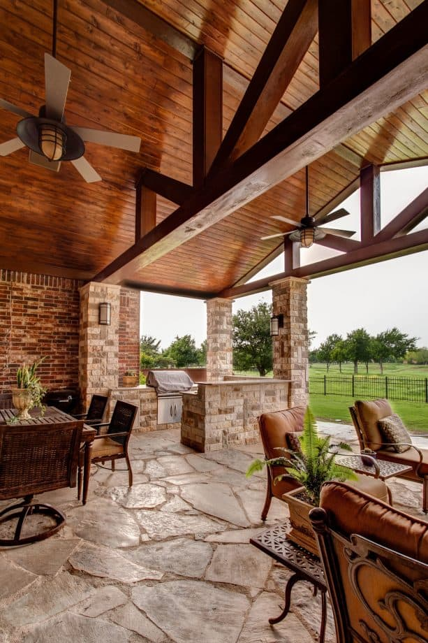 a traditional porch with stained pine tongue and groove ceiling