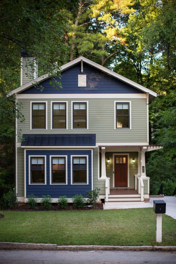 a unique exterior design with sage green and navy color combination