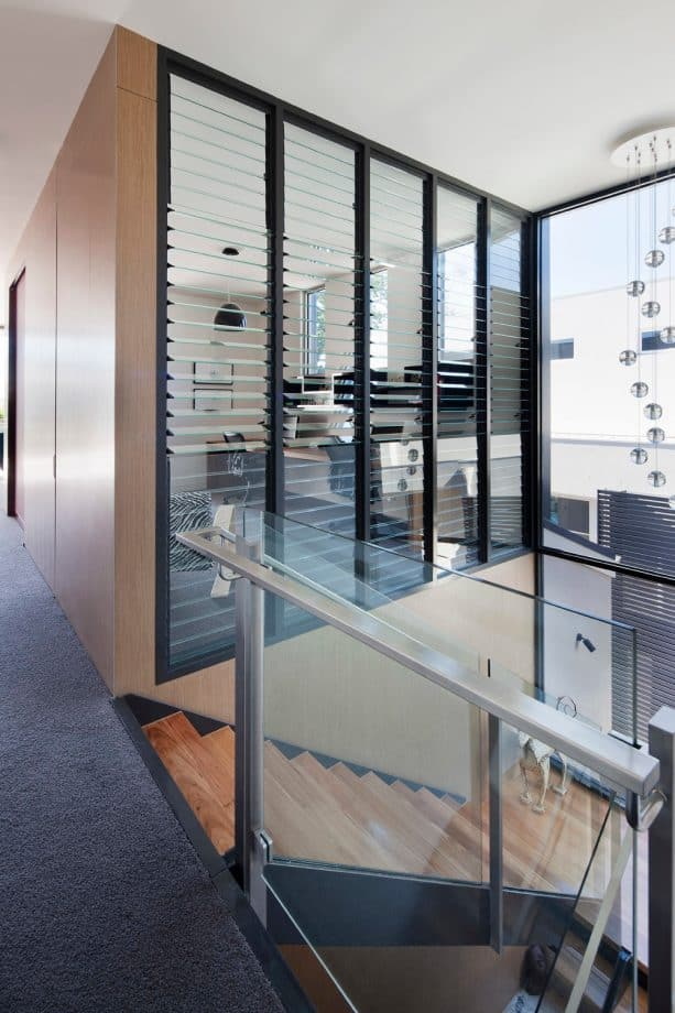 a home office with louvered glass interior windows