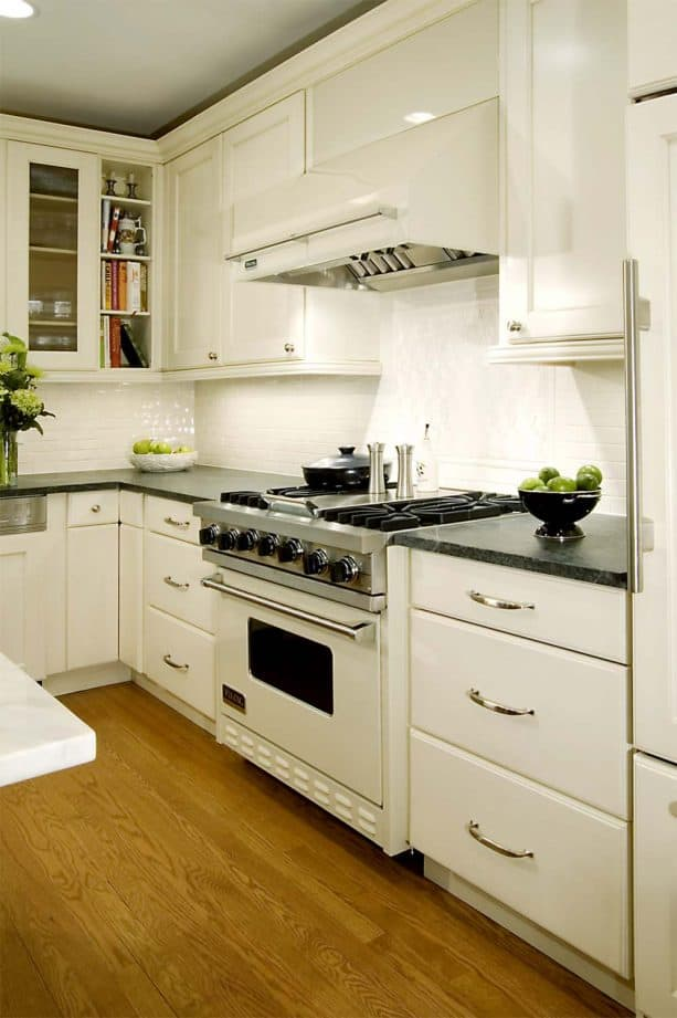 off-white kitchen cabinets and white stove