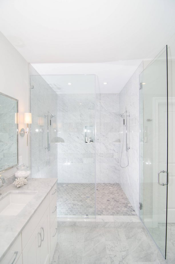 grey and white bathroom with frameless glass doors
