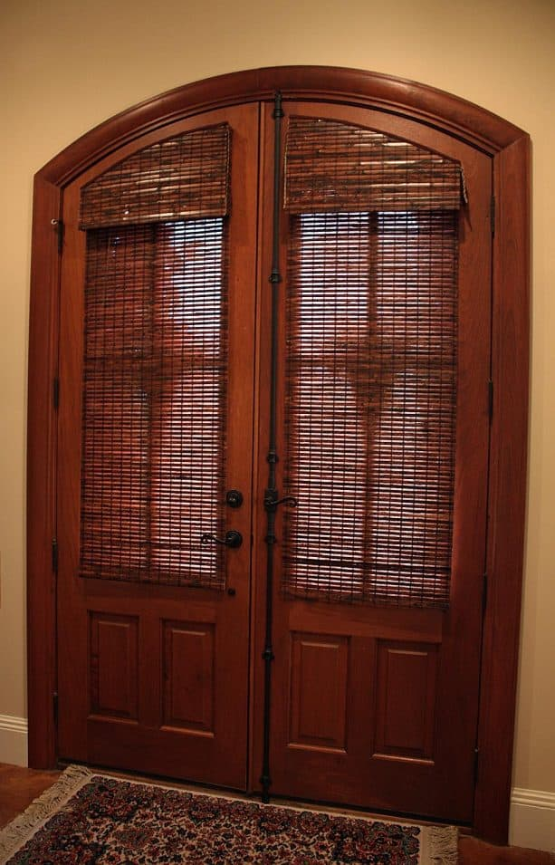 arched half glass doors with custom bamboo blinds