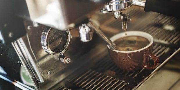 Red eye coffee being brewed on an espresso machine