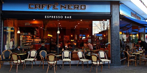 Sidewalk tables and chairs outside a Caffe Nero espresso bar in London
