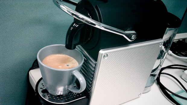 Nespresso Pixie plugged into the wall on a counter