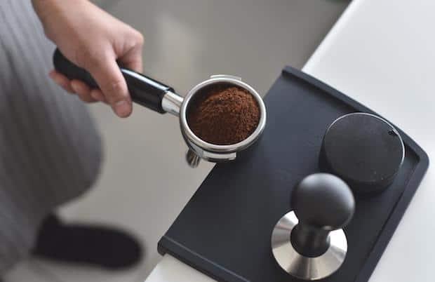 Uniform coffee grounds in a portafilter