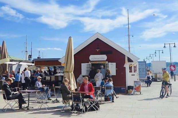 Waterfront sidewalk cafe in Oslo under a blue sky