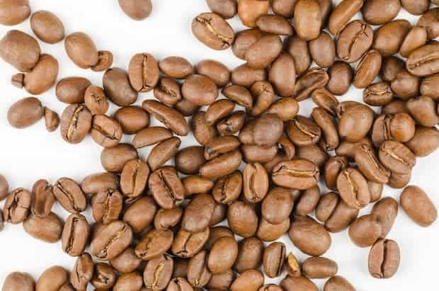 Overhead shot of light-roast coffee beans on a counter