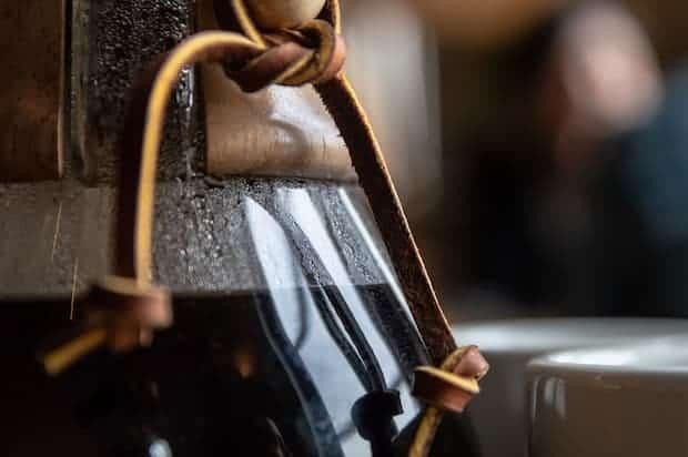 Closeup of hot coffee in a Chemex carafe