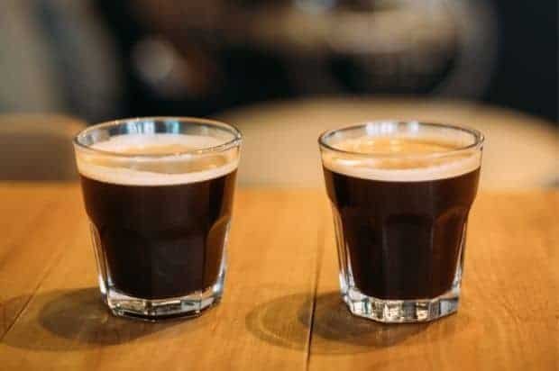 Two lungo espressos side by side in clear glasses