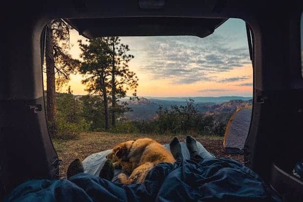 Beautiful sunrise view looking out the back of a camper van