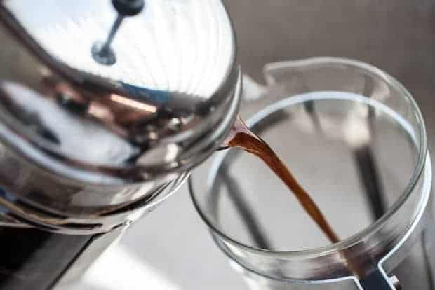 Pouring cold brew from a French press