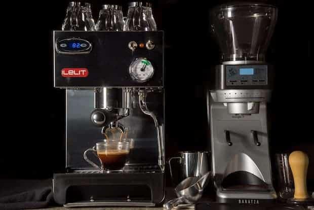 Lelit espresso machine next to a grinder