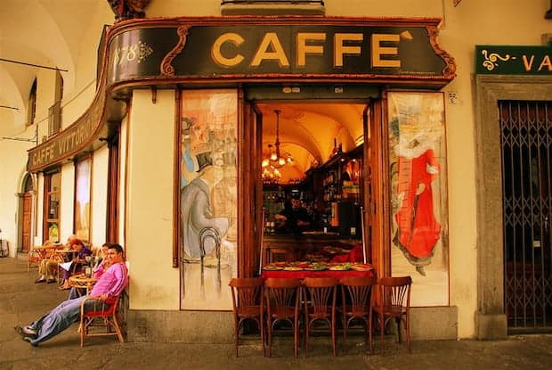 Patrons outside a caffe in Turin, Italy