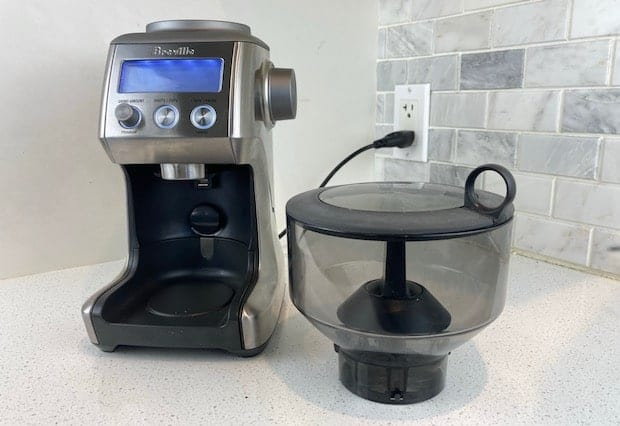 Breville Smart Grinder Pro on the counter with the bean hopper removed and resting on the counter in the foreground