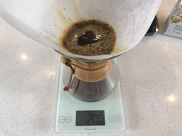 Coffee brewing in a Chemex on a scale