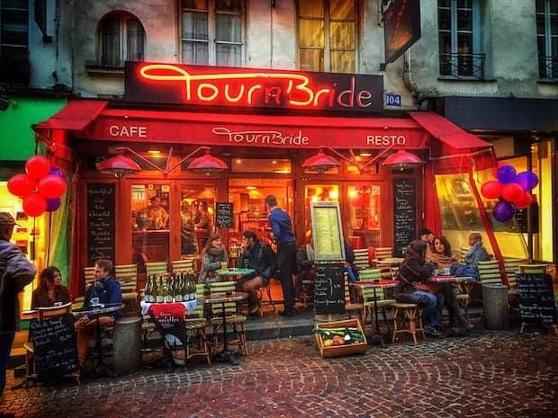 Patrons sit outside the Cafe Tournbride in Paris