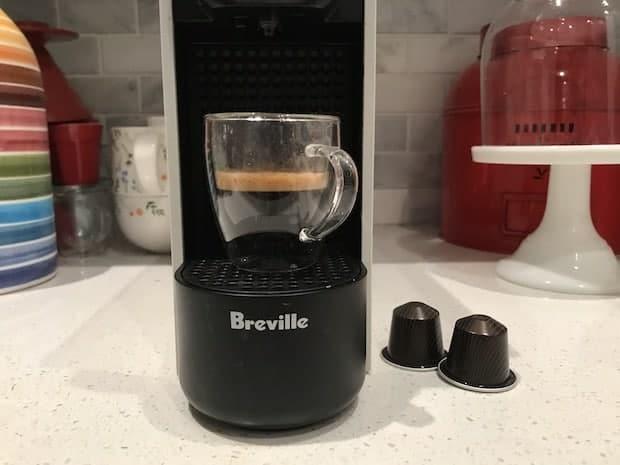 Shot of espresso sitting on the drip tray of a Nespresso Essenza Mini