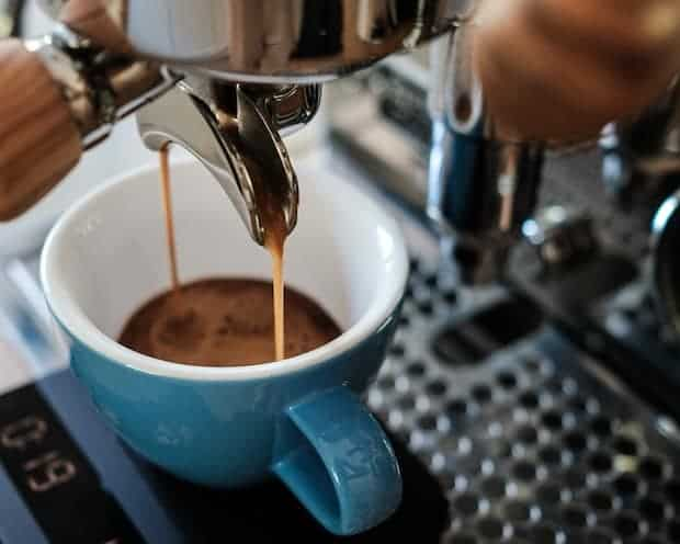 Espresso pouring out of a double spout into two cups