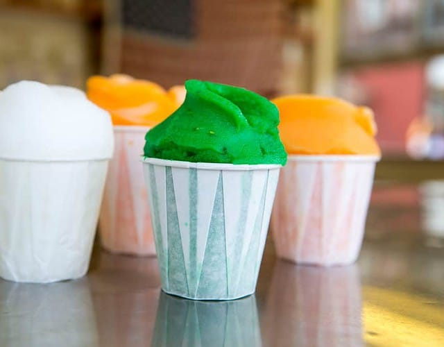 Green, white and orange italian ices from the lemon ice king in queens.