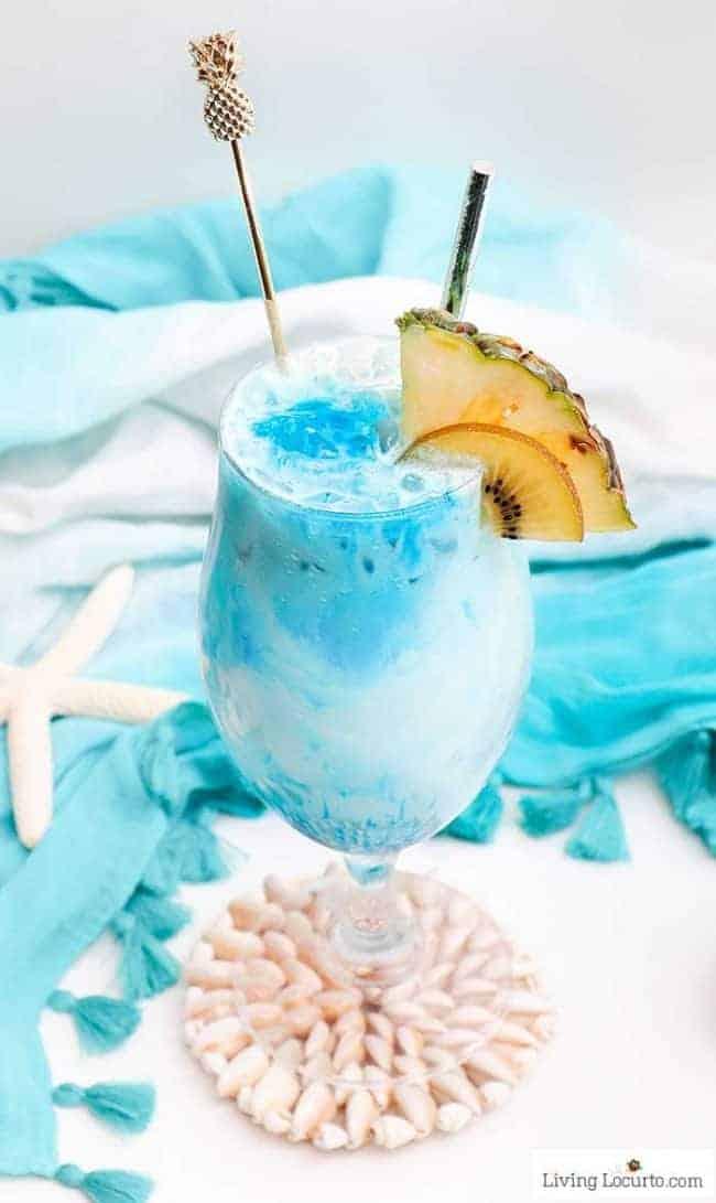 Mermaid Rum Punch - an ocean blue tropical drink recipe with lemonade, coconut, white rum, banana that's absolute magic!