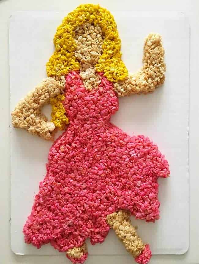 Emoji Dancing Girl Rice Krispies Cake - Emoji cake ideas and dessert inspiration for an Emoji Party. From birthday and graduation parties to school events, an emoji party theme is fun for all! LivingLocurto.com