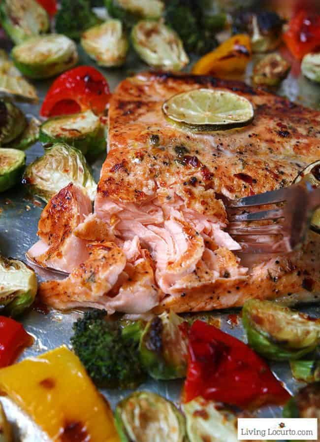 Sheet Pan Salmon dinner recipe! Sambal chili lime salmon with Brussels sprouts is an easy low carb dinner packed with flavor. LivingLocurto.com