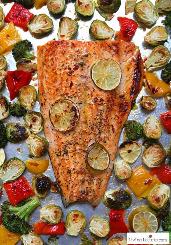 10 minute Sheet Pan Salmon dinner recipe! Sambal chili lime salmon with Brussels sprouts, broccoli and peppers is an easy low carb dinner packed with flavor.