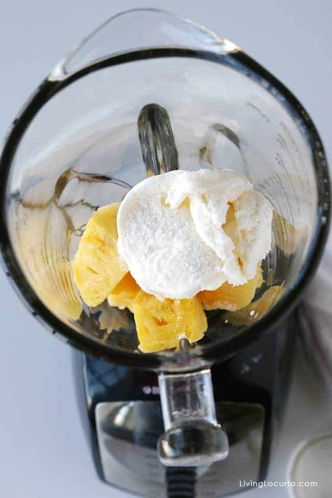 Pineapple Whip. How to make a copycat recipe for a Disney Animal Kingdom Pineapple Dole Whip with rum! LivingLocurto.com