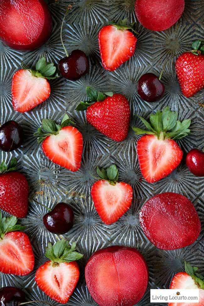 Fruity and Fresh Strawberry Plum Rosé Sangria. A perfect refreshing party cocktail recipe! LivingLocurto.com