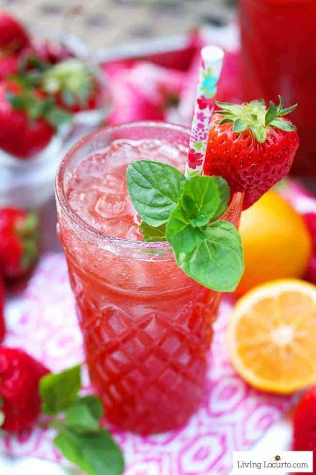 Strawberry Iced Tea recipe. Made by the pitcher with fresh strawberries, mint, lemons and is the perfect summer party cocktail.