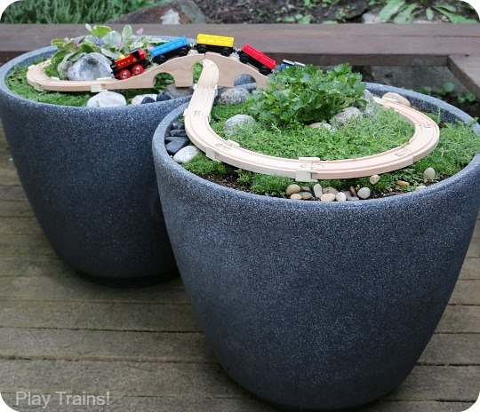 Toy Train garden in flower pots! Creative ways to add color and joy to a garden, porch, or yard with DIY Yard Art and Garden Ideas! Repurposed ideas for the backyard. Fun ideas for flower gardens made from logs, bikes, toys, tires and other old junk. ~ featured at LivingLocurto.com