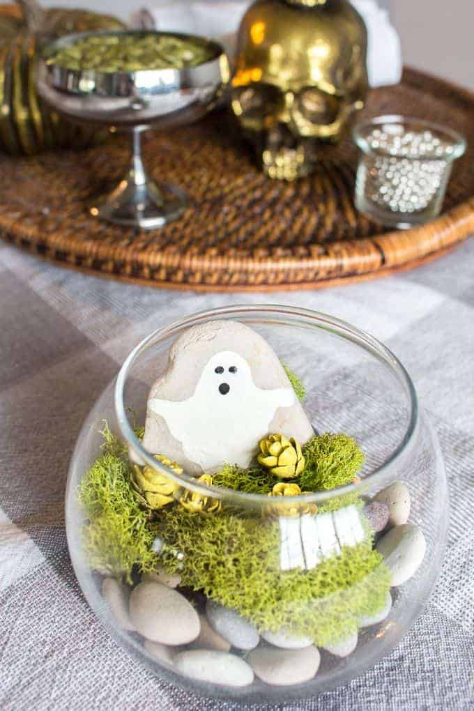 up close halloween terrarium with painted ghost