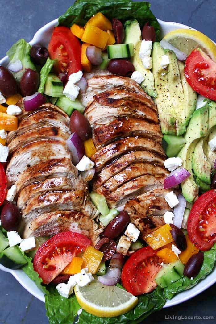 Baked Chicken Greek Salad with Avocado and fresh vegetables. Juicy chicken and fresh avocado slices loaded onto a Greek salad is a low carb recipe packed with flavor!